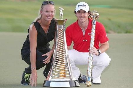 Wozniacki y McIlroy, tras ganar el golfista la Race to Dubai