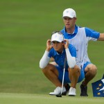 Azahara Muñoz and her caddie and boyfriend Tim check the putting line on the 10th green