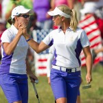 Carlota Ciganda and Suzann Pettersen celebrate winning a hole