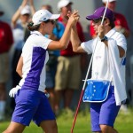 Carlota Ciganda celebrates winning the hole with her caddie