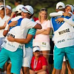 Carlota Ciganda celebrates her win on the 18th hole with her caddie Javier with Azahara Munoz celebrating with her caddie Tim in the background