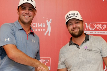 Ryan Moore y Gary Woodland. Foto: Asian Tour