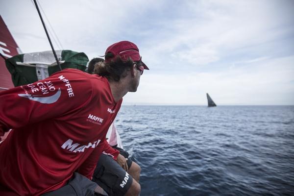 October 11, 2014. Leg 1 onboard MAPFRE: Iker Martinez staring at Team Brunel